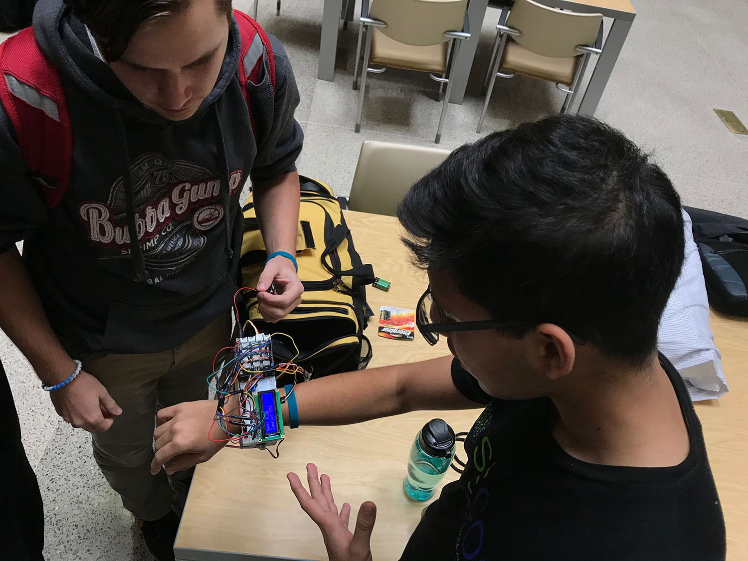 Group working on a watch-type device to measure vital signs